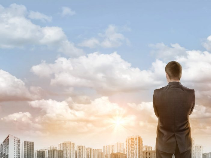 Man looking at clouds pondering solution providers for cloud services