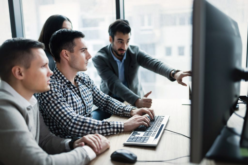 cybersecurity consultants discussing plan on computer screen